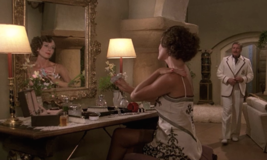 diana rigg at dressing table.png